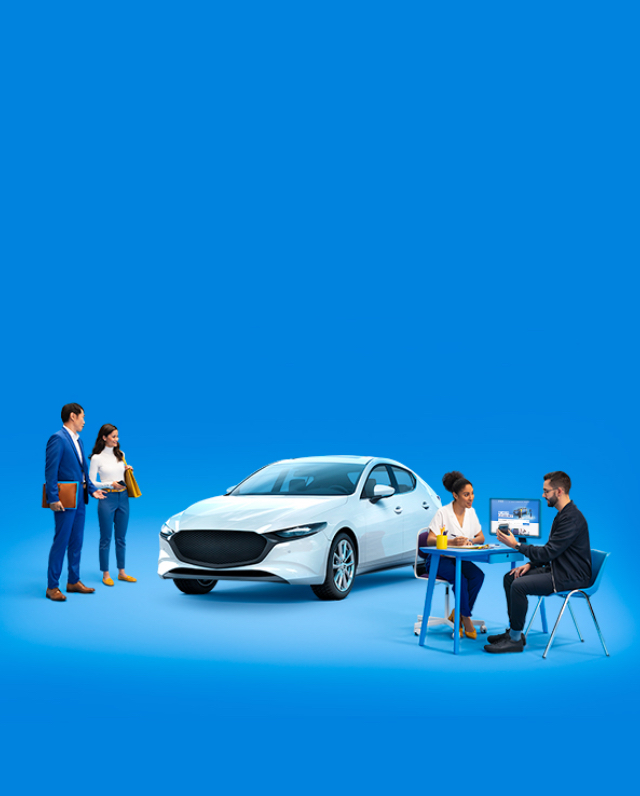 Two people seated looking at a smartphone, two people admiring a white car